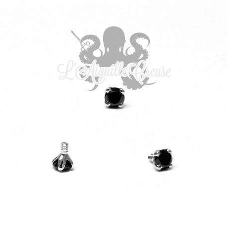 Diamant noir griffé d'or blanc 18 carats pour 1.2 mm